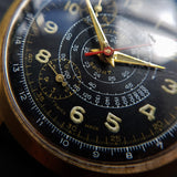 Macro Shot of Vintage 1950s Cimier Sport Gold Mechanical Chronograph with Black Leather Strap with Red Stitching