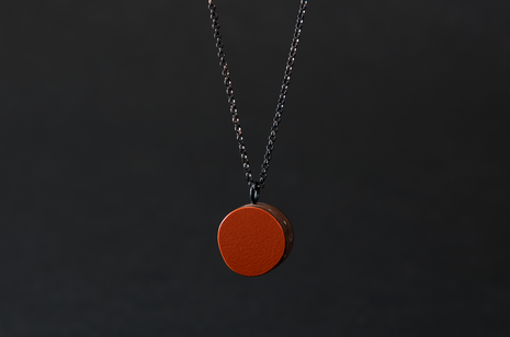 Orange Circle and Inlay Pendant by Emily Kidson