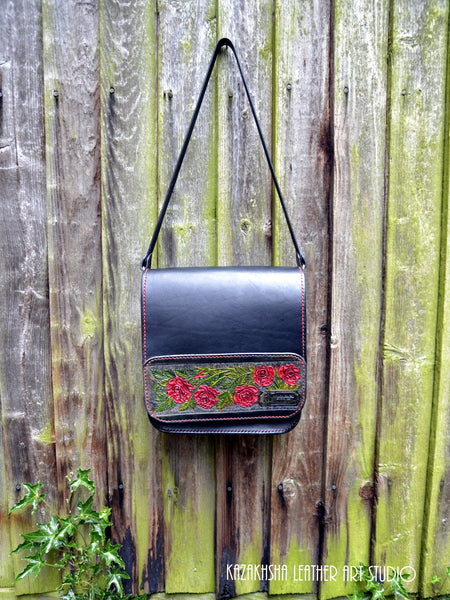 Black leather messenger bag with red roses with a complimentary roses book-marker