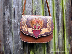 Leather tooled saddle hand bag styled based on Celtic Claddagh and Kazakh Shanyrak, - Kazakhsha Leather Art Studio