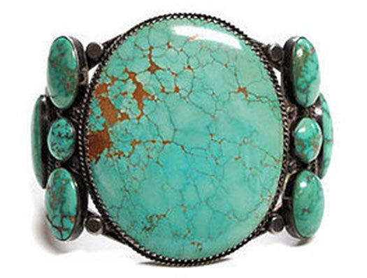 (2 Navajo)-Silver-and-Carico-Lake-Turquoise.-ca.-1970s