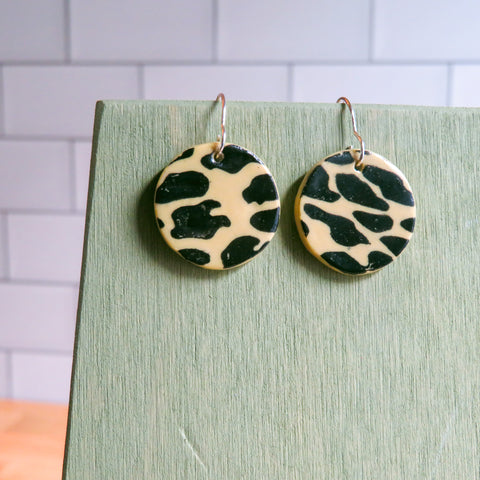 Black Leopard Earrings on Beige Clay