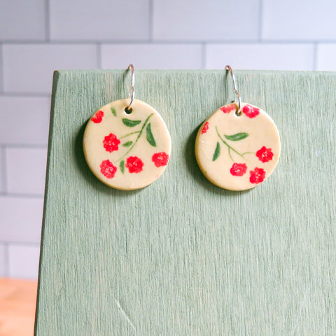 Red Blossom Earrings on Beige Clay