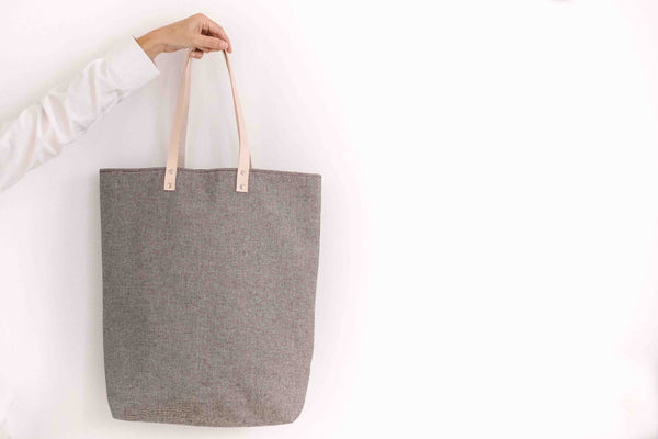 A sophisticated and multitask tote bag to carry around all the items one needs on a long day.