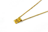 Eyes of Buddha scroll necklace - gold