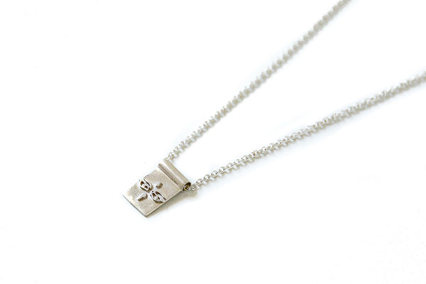 Eyes of Buddha scroll necklace - silver