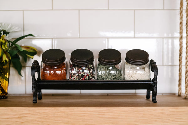 Decorative Glass Jars With Cast Iron Lids And Rack The