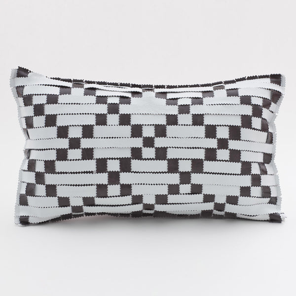 white and grey leather cushion