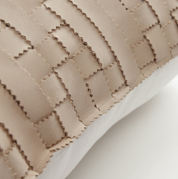 tan leather cushion