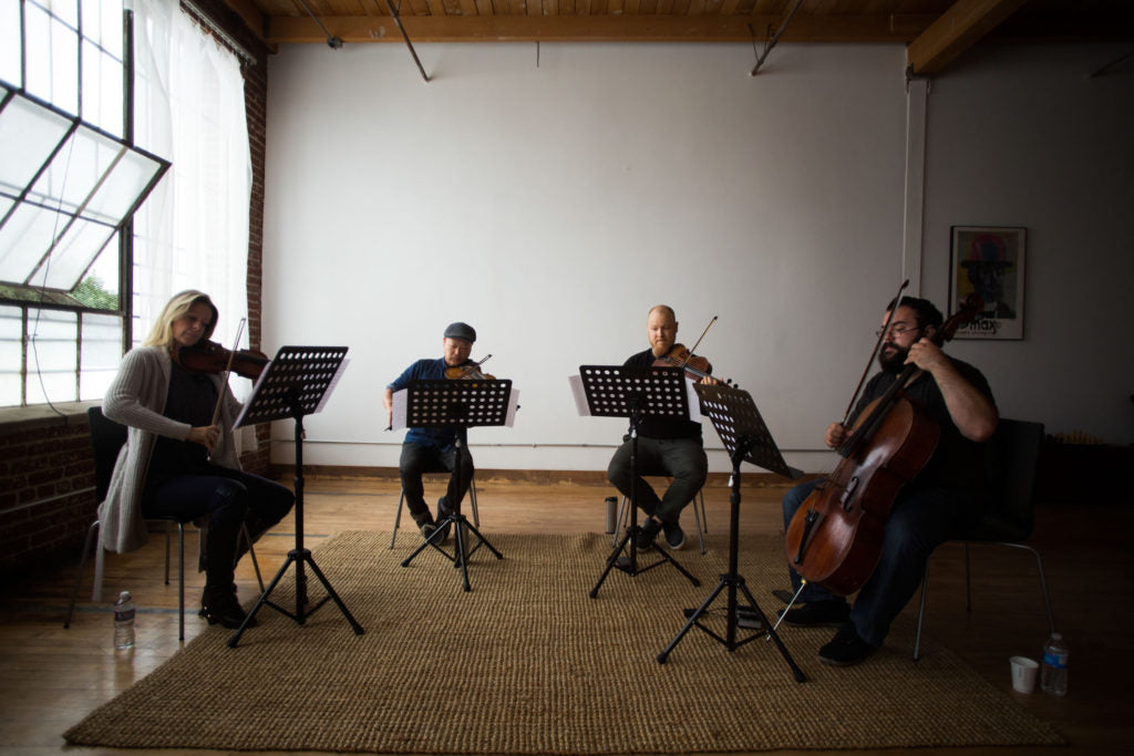 Vitamin String Quartet reading at a loft in Los Angeles, Cali., on Wednesday, Oct. 12, 2016. (© 2016 Jenna Schoenefeld. CMH Label Group/VSQ Usage only.)