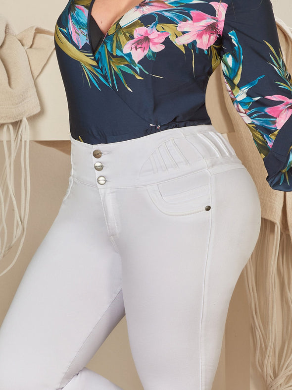 up close view butt lift white colombian jeans with blue floral bodysuit
