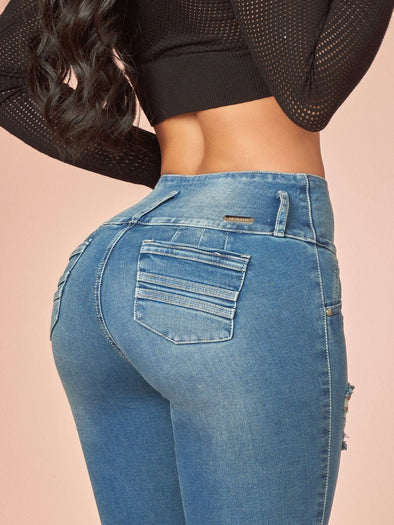 up close view butt lift jeans with pockets blue and black crop top