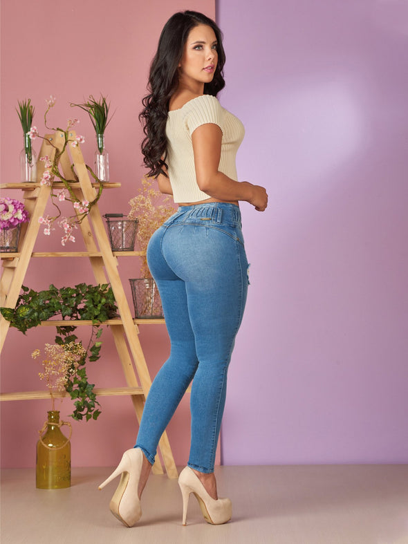 light wash butt lift jeans with no pockets and beige top and beige heels