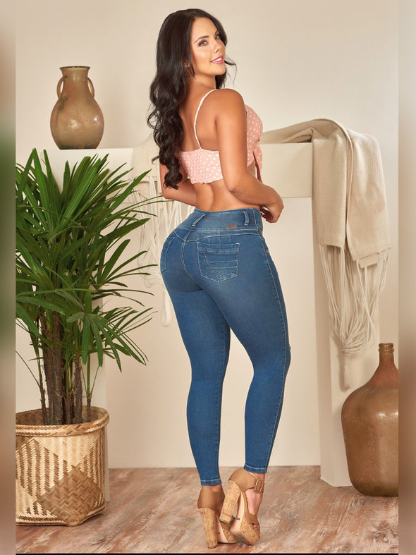 back view colombian skinny jeans wearing beige heels and pink crop top