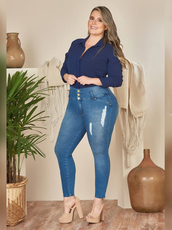 plus size model wearing skinny butt lift colombian jeans with button blouse and  blonde hair