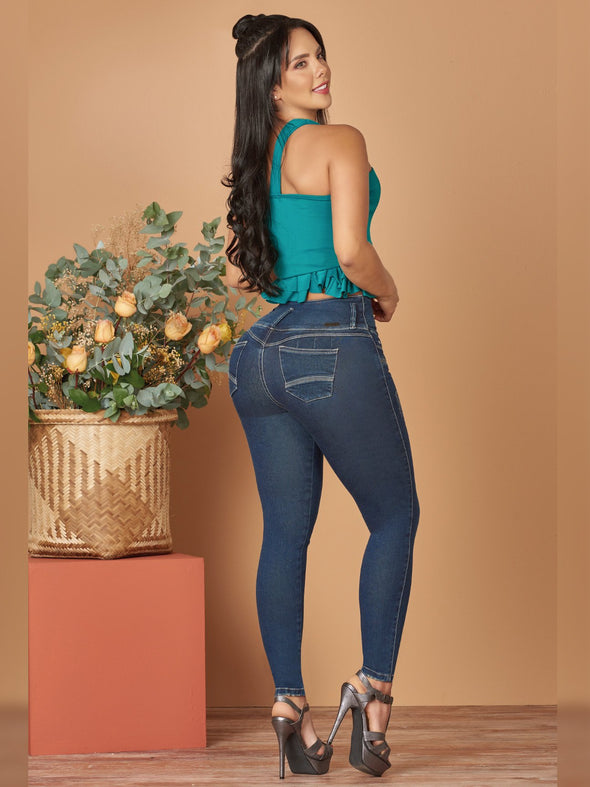 back view colombian butt lift jeans with black high heels and turquoise crop top
