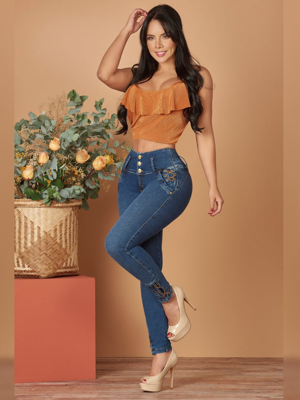 colombian woman wearing dark wash skinny butt lift jeans and nude high heels