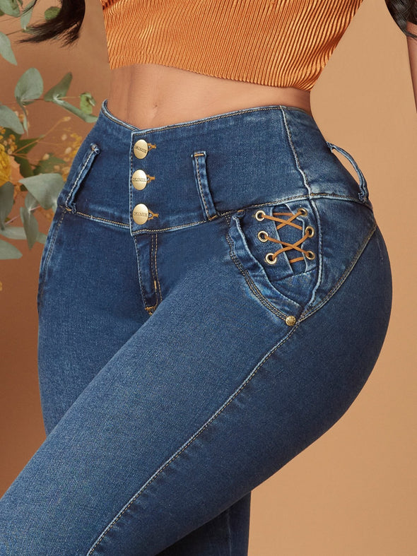 dark wash butt lift colombian jeans criss cross design and gold buttons