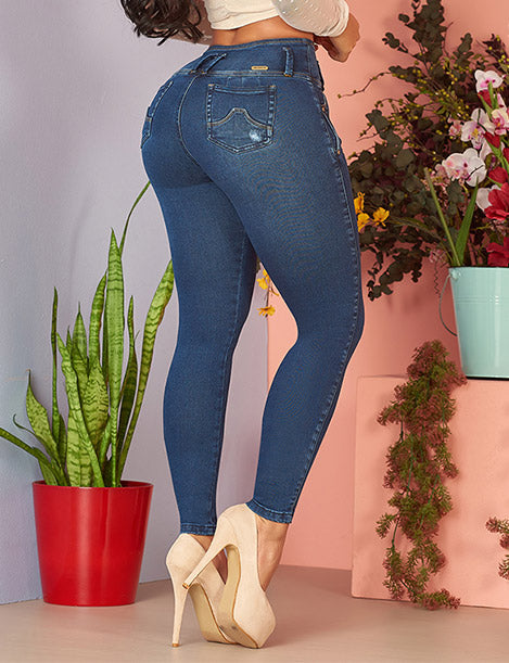 up close view of colombian butt lift jeans dark denim with yellow tone nude heels