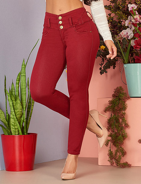 up close view wine colored butt lifting skinny jeans with three buttons and nude heels