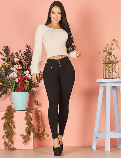 colombian girl with dark long curly hair wearing sweater creme crop top and curvy butt lifting black skinny jeans and black high heels