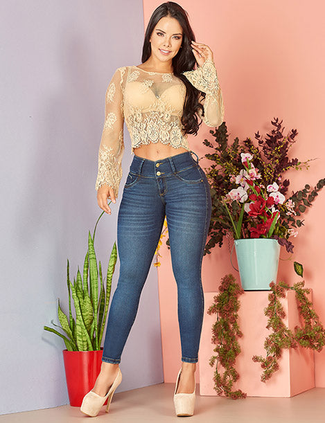 colombian girl with long dark hair wearing long crop top with lace see through and colombian butt lift dark denim jeans