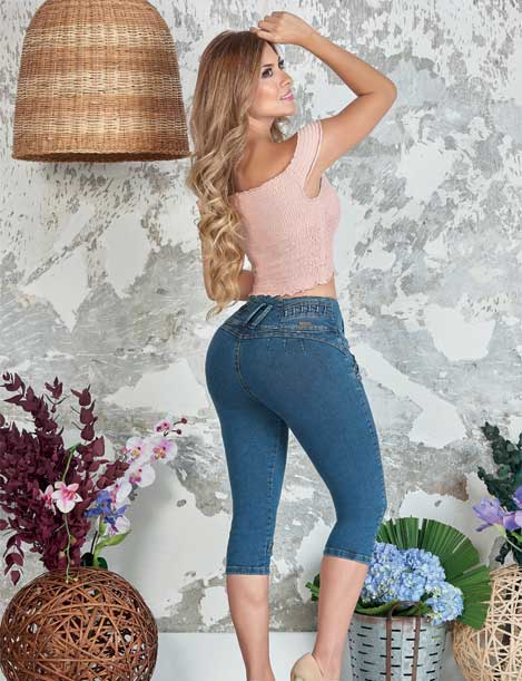 beautiful long blonde hair colombian woman wearing pink crop top and dark blue push up capri jeans