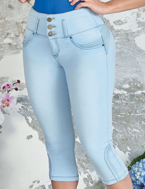 close up front view of woman wearing capri butt lifter three button push up jeans ligh wash