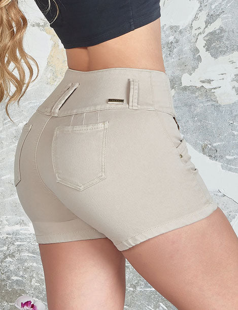 up close of colombian butt lifter jeans with black crop top with pockets beige