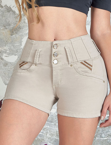 up close view of butt lifter beige shorts with three buttons and gold details