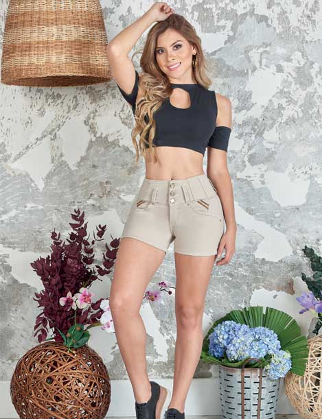 blonde long hair colombian girl wearing beige shorts with black crop top