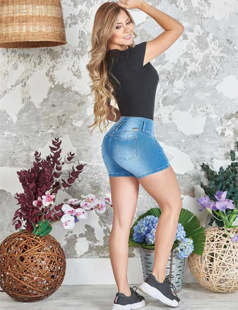pretty long blonde hair colombian woman wearing black top and butt lift shorts and sneakers side view