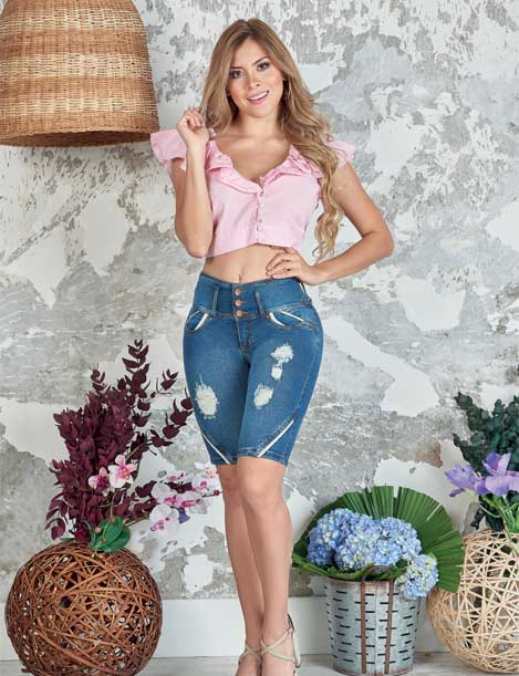 blonde colombian girl wearing pink crop top blouse and dark blue wash capri jeans butt lift with distress denim