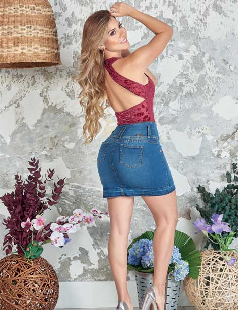 back view of blonde colombian girl wearing backless top and denim butt lift skirt