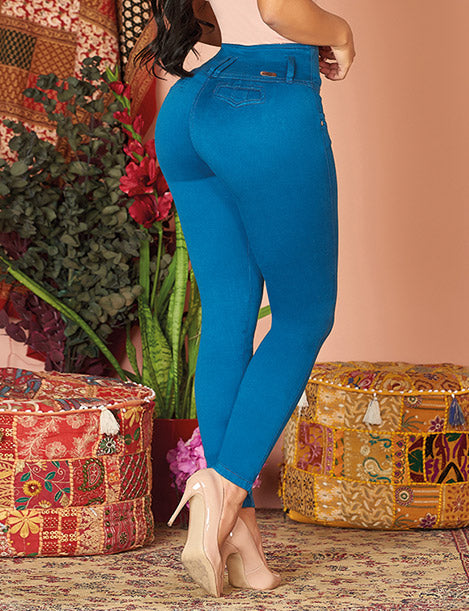close up view of bright blue colombian jeans with nude heels