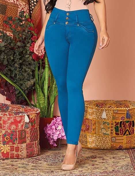 up close view of bright medium blue colombian skinny jeans with nude heels