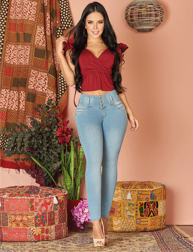 beautiful colombian wearing red crop top and high waist butt lift light wash jeans and heels