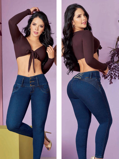 latina dark hair woman wearing brown crop top and blue corset jeans