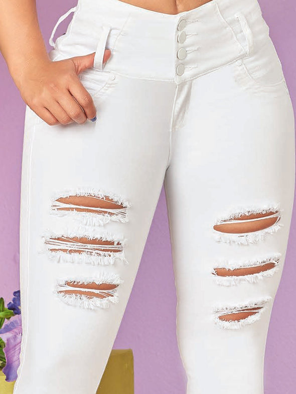 up close view distressed white jeans with white buttons