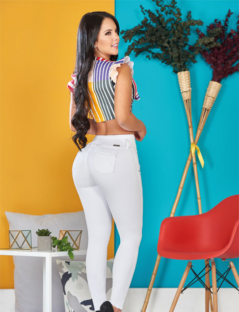 back view of colombian black hair woman long hair wearing colorful crop top and butt lifter push up jeans white