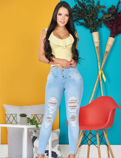 dark hair colombian girl with ripped jeans wearing light was levantacola and yellow top