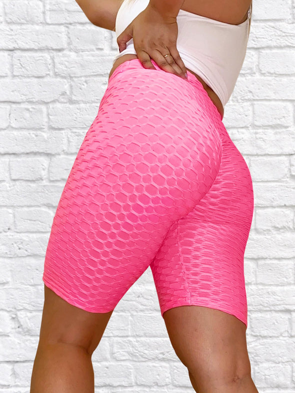 Model Wearing Nicolette Shapewear's 'Bootylicious' Textured Butt Lift Biker Shorts w/ Scrunch Booty Pink