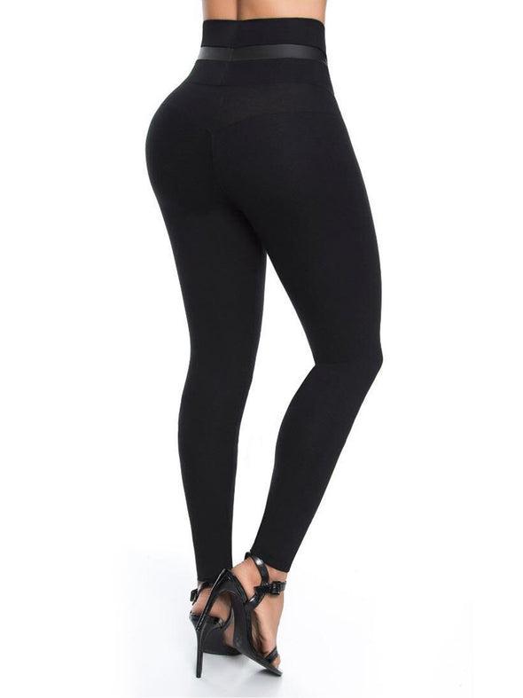 back view of black butt lift leggings colombian with black high heels,