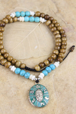 Bone and Turquoise Compassion Mantra Pendant Necklace