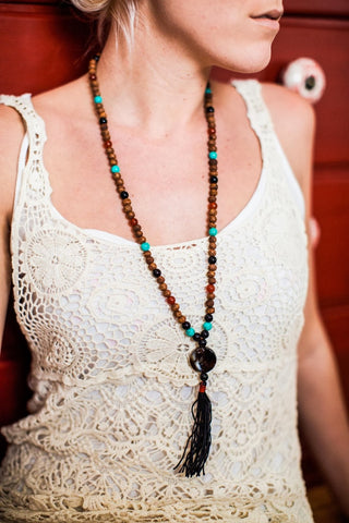 Tibetan Seed Mala with Turquoise Spaces