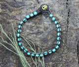 Turquoise-Colored Bead Bracelet