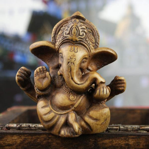 Four Armed Baby Ganesh Statue