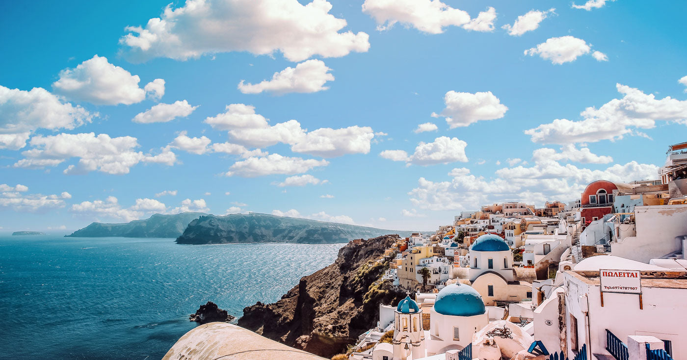Santorini panorama including blue church roofs