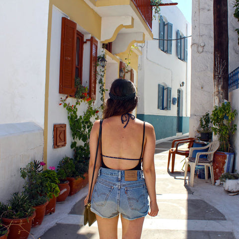 Woman in greece from behind