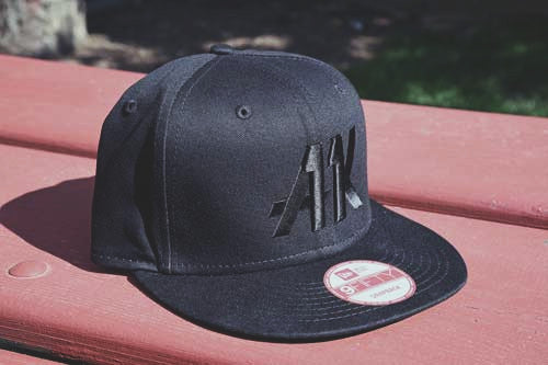 AK11 black-on-black snapback from the left